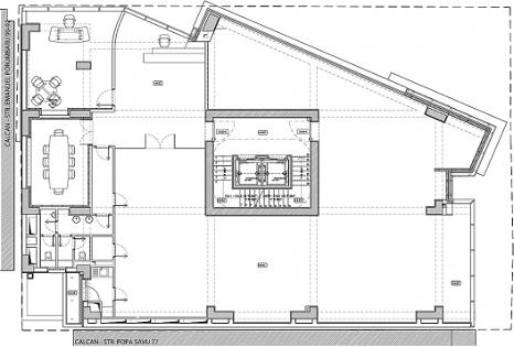 Arquitectos igloo planos de edificio hecho con granito negro