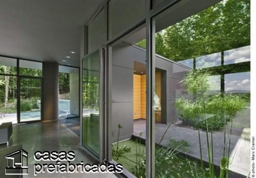 300 m2 T- House en Canadá por Natalie Dionne Architecture (7)