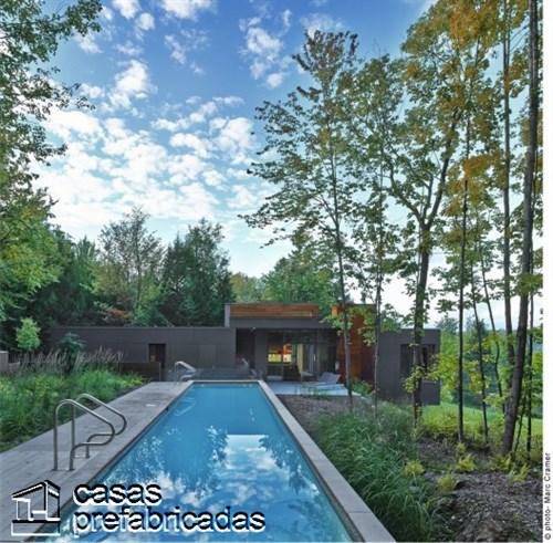 300 m2 T- House en Canadá por Natalie Dionne Architecture (9)