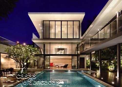 Perfecta casa moderna construida sobre terreno irregular (10)