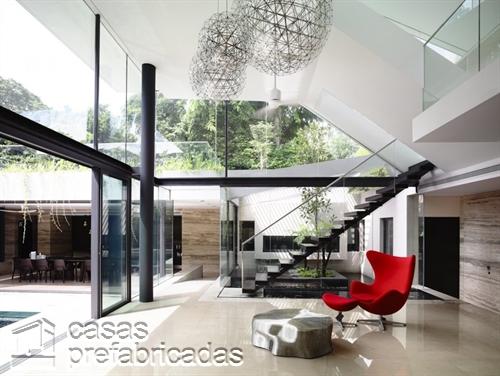Perfecta casa moderna construida sobre terreno irregular (11)