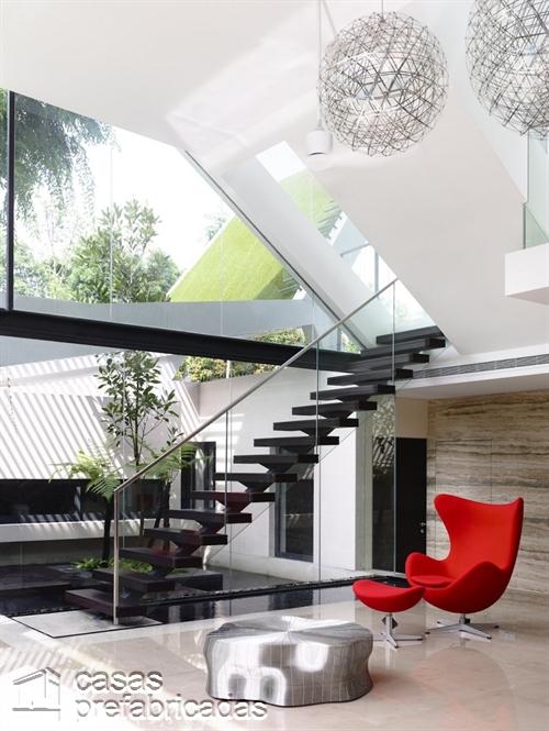 Perfecta casa moderna construida sobre terreno irregular (12)