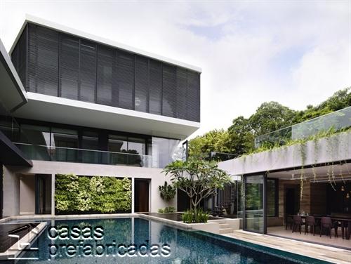Perfecta casa moderna construida sobre terreno irregular (6)