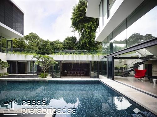 Perfecta casa moderna construida sobre terreno irregular (7)