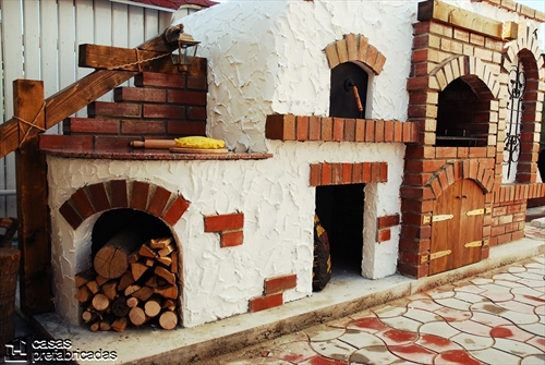 Bellas fachadas que incorporan hornos y cocinas coloniales en sus exteriores (31)