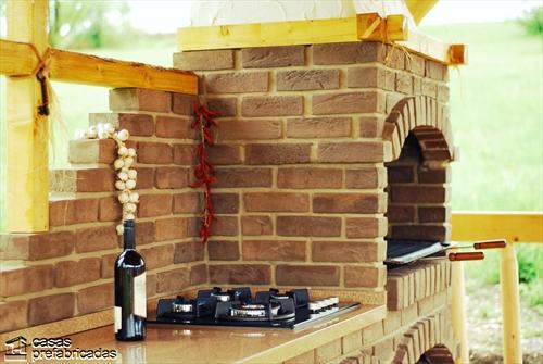 Bellas fachadas que incorporan hornos y cocinas coloniales en sus exteriores (46)