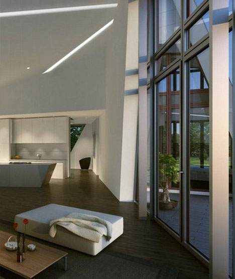 Se concentran techos   altos  y ventanas grandes para ofrecer un espacio minimalista